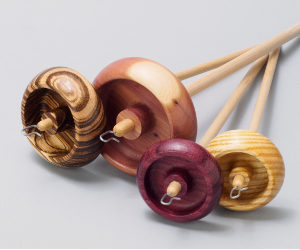 Four sizes of handcrafted wooden drop spindles for spinning