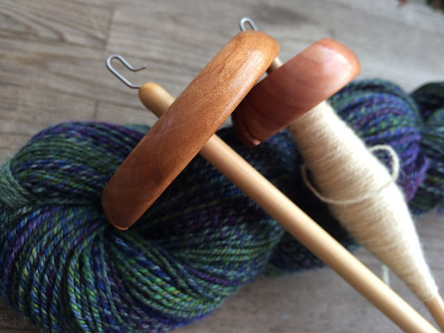Two Bosworth Spindles on skein of blue and green wool